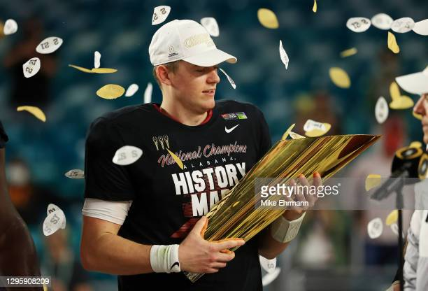 Mac Jones of the Alabama Crimson Tide holds the trophy following their win over the Ohio State Buckeyes in the College Football Playoff National...