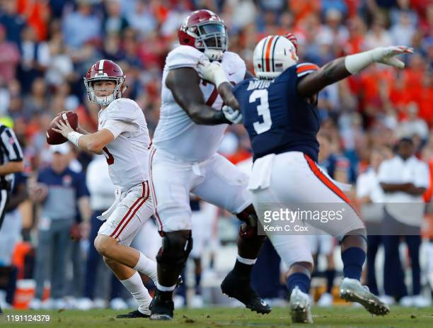 Mac Jones of the Alabama Crimson Tide looks to pass against the Auburn Tigers in the first half at Jordan Hare Stadium on November 30, 2019 in...