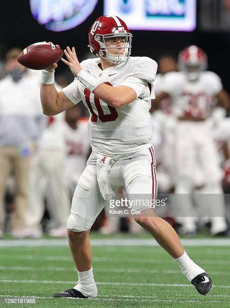Mac Jones of the Alabama Crimson Tide looks to pass against the Florida Gators during the first half of the SEC Championship at Mercedes-Benz Stadium...