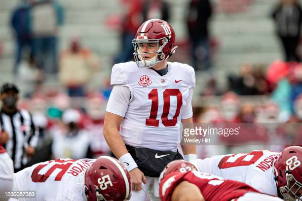 Mac Jones of the Alabama Crimson Tide looks to the sidelines for the play in the first half of a game against the Arkansas Razorbacks at Razorback...