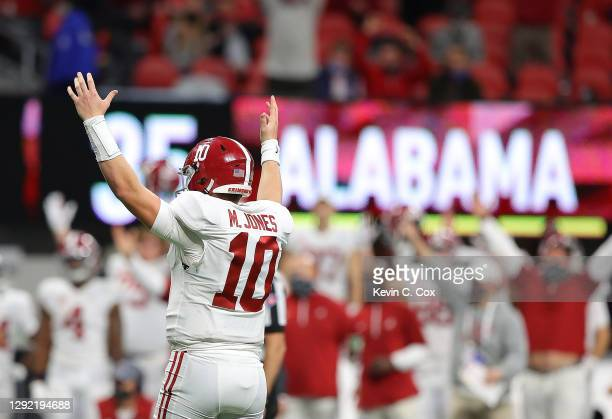 Mac Jones of the Alabama Crimson Tide reacts after a rush by Najee Harris against the Florida Gators during the second half of the SEC Championship...