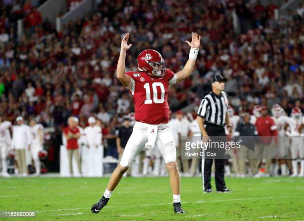 Mac Jones of the Alabama Crimson Tide reacts after a rushing touchdown by Najee Harris in the first half against the Arkansas Razorbacks at...