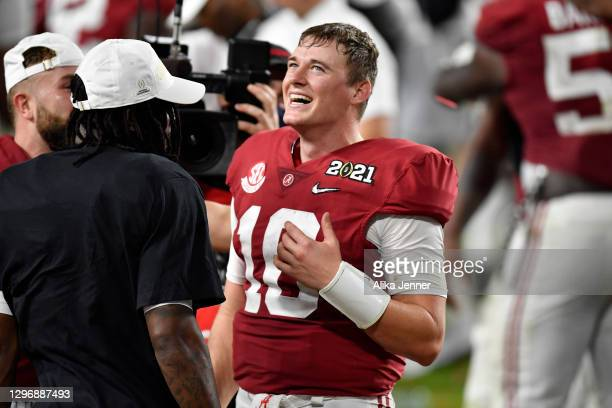 Mac Jones of the Alabama Crimson Tide smiles after the College Football Playoff National Championship football game against the Ohio State Buckeyes...