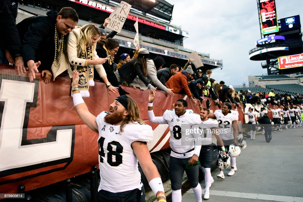 Mac Loudermilk #48 of the UCF Knights high-fives fans after the win at Lincoln Financial Field on November 18, 2017 in Philadelphia, Pennsylvania. UCF defeated Temple 45-19.