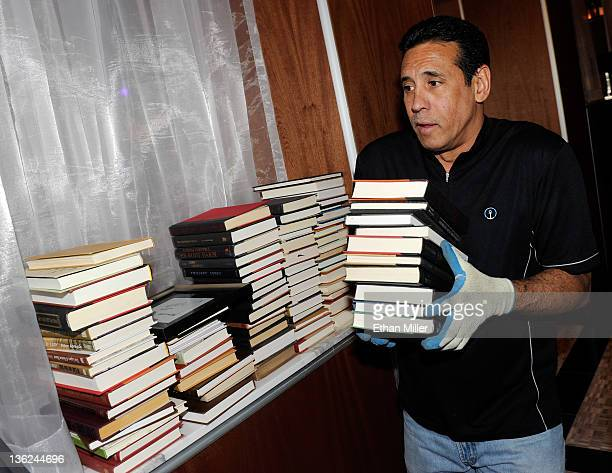 Mac Macayanan stacks books to be used as decor as preparations continue for the opening of Hyde Bellagio at the Bellagio December 29 2011 in Las...