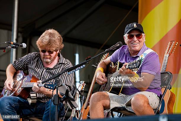 Mac McAnally and Jimmy Buffett perform an acoustic set during the 2012 New Orleans Jazz Heritage Festival at the Fair Grounds Race Course on May 3...