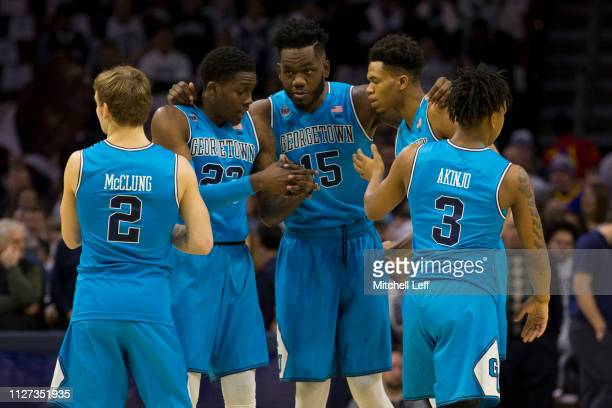 Mac McClung Josh LeBlanc James Akinjo Jessie Govan and Jamorko Pickett of the Georgetown Hoyas huddle prior to the game against the Villanova...