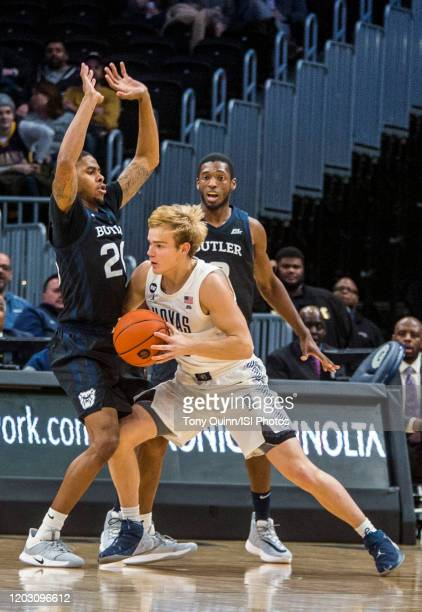 Mac McClung of Georgetown pushes into Henry Baddley of Butler during a game between Butler and Georgetown at Capital One Arena on January 28 2020 in...