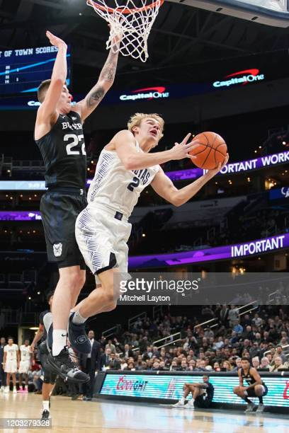 Mac McClung of the Georgetown Hoyas drives to the basket by Sean McDermott of the Butler Bulldogs dribbles the ball during a college basketball game...