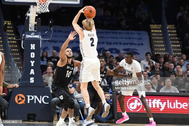 Mac McClung of the Georgetown Hoyas takes a shot over Bryce Nze of the Butler Bulldogs during a college basketball game at the Capital One Arena on...