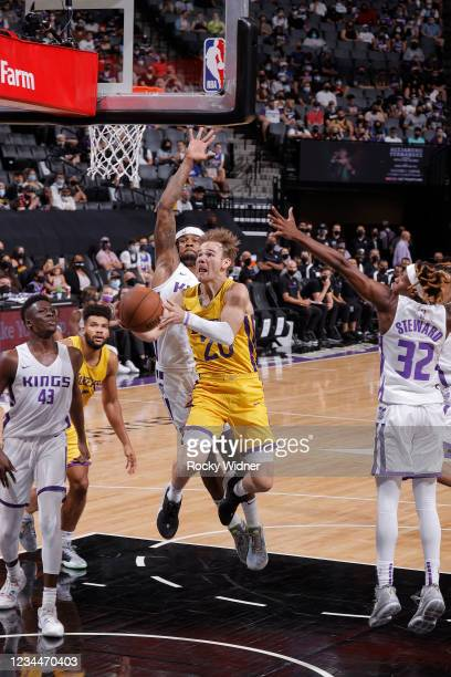 Mac McClung of the Los Angeles Lakers drives to the basket against the Sacramento Kings during the 2021 California Classic Summer League on August 4,...