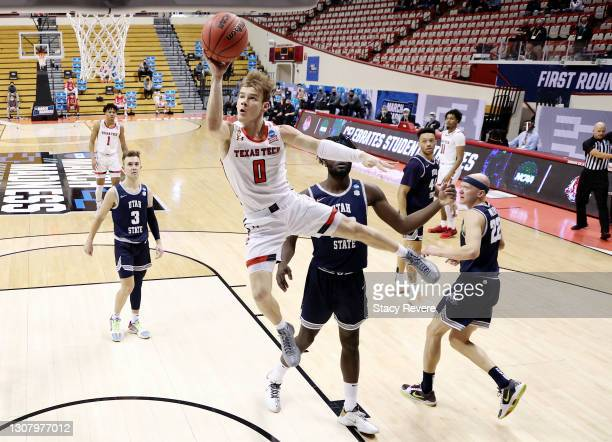 Mac McClung of the Texas Tech Red Raiders drives to the basket during the first half against the Utah State Aggies in the first round game of the...