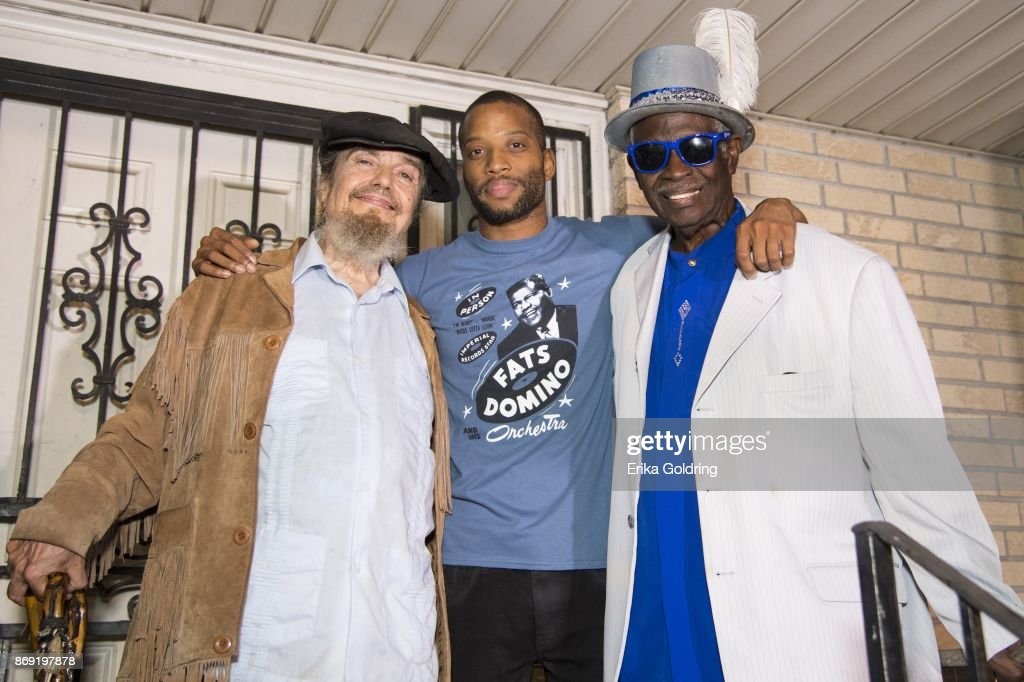 Mac Rebennack aka Dr. John, Troy 'Trombone Shorty' Andrews and Al 'Carnival Time' Johnson pose for a photo on the porch of the former home of music legend Antoine 'Fats' Domino during a second line parade honoring him on November 1, 2017 in New Orleans, Louisiana. Domino passed away last week at the age of 89.
