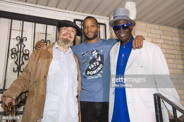 Mac Rebennack aka Dr John Troy 'Trombone Shorty' Andrews and Al 'Carnival Time' Johnson pose for a photo on the porch of the former home of music...