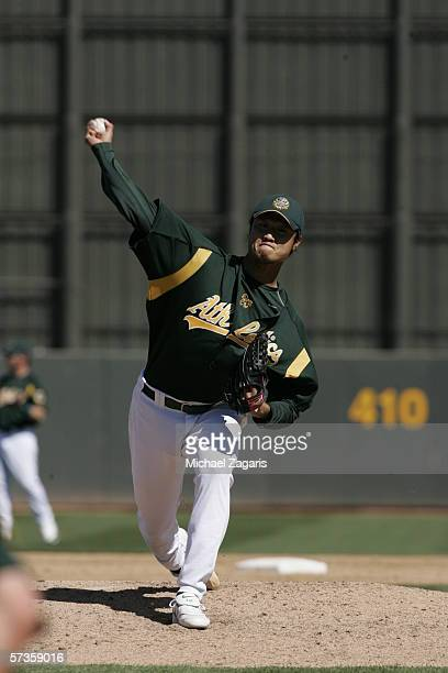 Mac Suzuki of the Oakland Athletics pitches during a Spring Training game against the Milwaukee Brewers at Phoenix Municipal Stadium on March 3 2006...