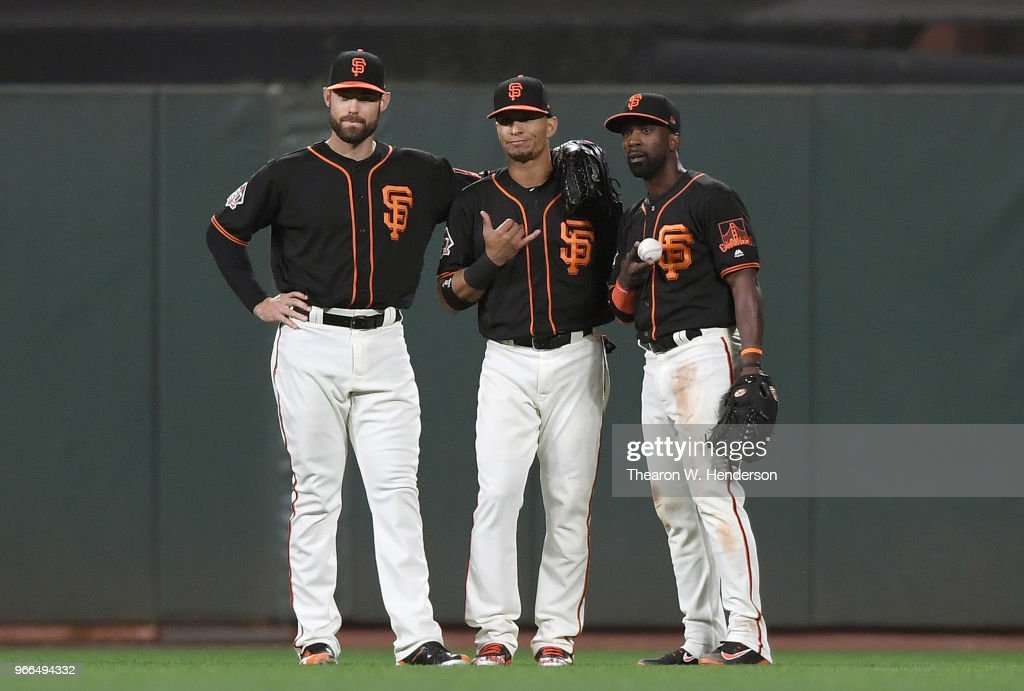 Mac Williamson #51, Gorkys Hernandez #7 and Andrew McCutchen #22 of the San Francisco Giants celebrates defeating the Philadelphia Phillies 2-0 at AT&T Park on June 2, 2018 in San Francisco, California.