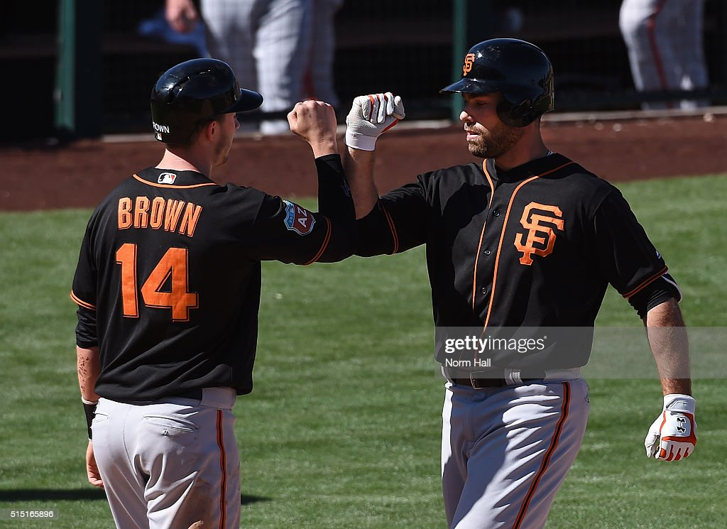 Mac Williamson #51 of the San Francisco Giants celebrates with teammate Trevor Brown #14 after hitting a two run home run against the Los Angeles Angels of Anaheim during the fifth inning at Tempe Diablo Stadium on March 12, 2016 in Tempe, Arizona.