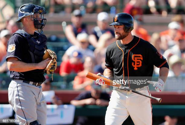 Mac Williamson of the San Francisco Giants reacts after striking out in the fourth inning against the Cleveland Indians during the spring training...