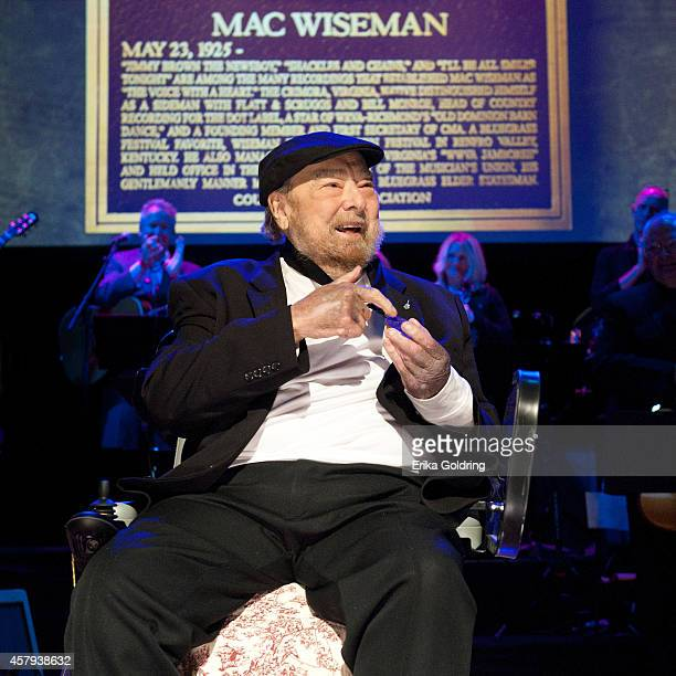 Mac Wiseman receives his CMHOF medallion during the 2014 Country Music Hall of Fame induction ceremony at Country Music Hall of Fame and Museum on...