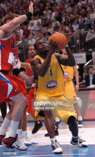 Macabbi Tel Aviv's Will Bynum tries to get the shot off over CSKA Moscow's David Andersen during the NBA Europe Live Tour presented by EA Sports on...