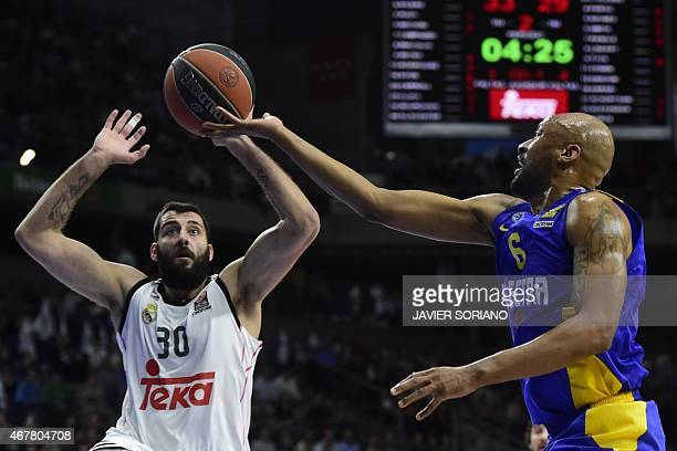 Macabi Electra Tel Aviv's US guard Devin Smith vies with Real Madrid's Greek centre Ioannis Bourousis during the Euroleague basketball Group E round...