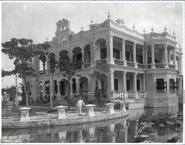 Macao China View of a gambling king's palace in the midst of a lilycovered lagoon Undated photograph