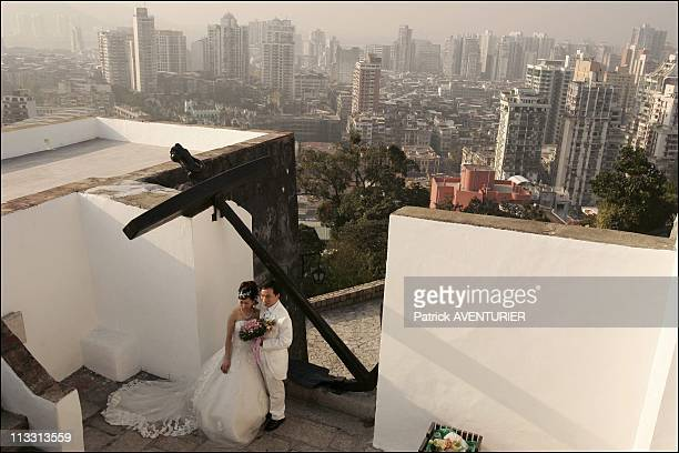 Macao The Chinese Gambling Empire On January 6Th 2006 In Macao Here NewlyWed Couple On The Terrace Of 17Th Century Guia Fortress Overlooking Macao...