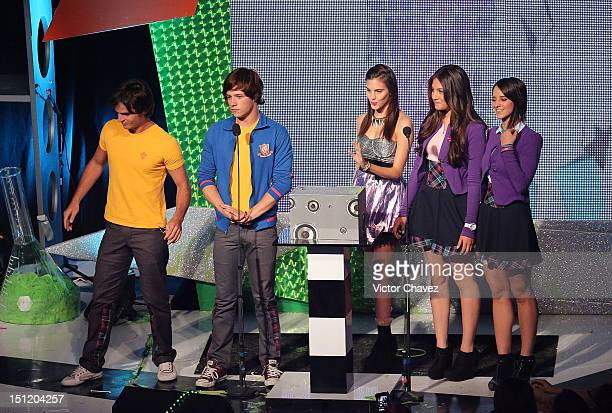 Macarena Achaga of M15 and cast members of the soap opera Miss XV speak onstage at the Kids Choice Awards Mexico 2012 at Pepsi Center WTC on...