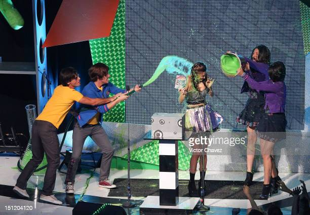 Macarena Achaga winner of favorite latin villian gets slimed onstage by cast members of soap opera Miss XV at the Kids Choice Awards Mexico 2012 at...