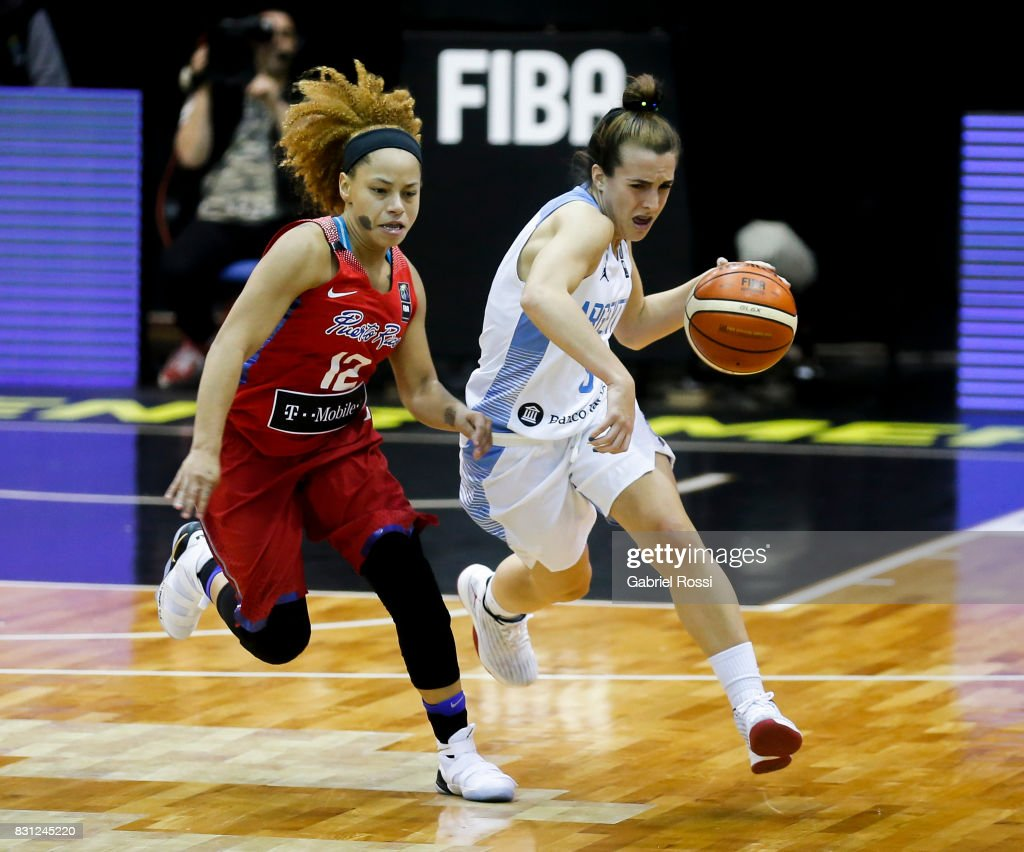 Macarena Durso of Argentina fights for the ball with Dayshalee Salam of Puerto Rico during a match between Argentina and Puerto Rico as part of the FIBA Women's AmeriCup Semi Final at Obras Sanitarias Stadium on August 12, 2017 in Buenos Aires, Argentina.