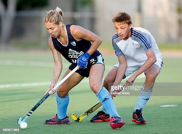 Macarena Rodriguez Perez tries to evade a male defender during a training session as part of Argentina Female Hockey Team preparation for Hockey...