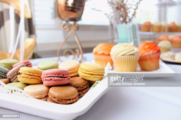 Macarons and cupcakes on plates, France
