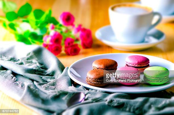 Macarons with coffee and roses