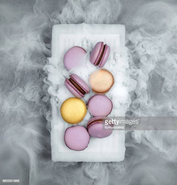 macarons with dry ice - macarons stock photos and pictures