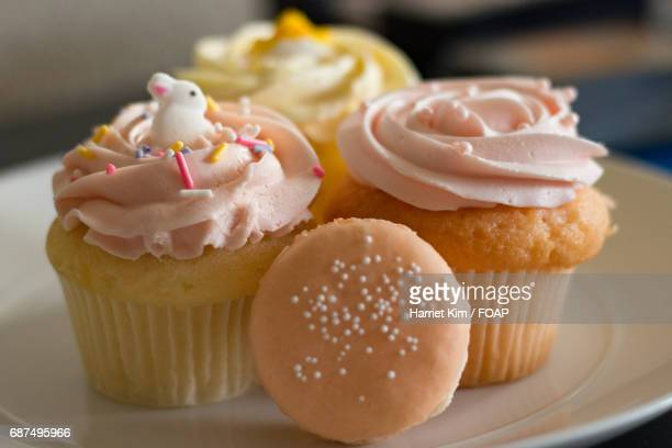 macaroon and cupcakes - harriet stock photos and pictures