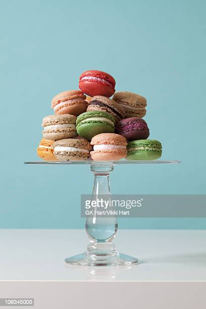 macaroon cookies on teal background - cakestand stock pictures, royalty-free photos & images