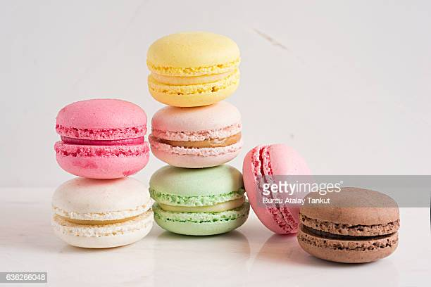 macaroons in different colours - macarons stock photos and pictures