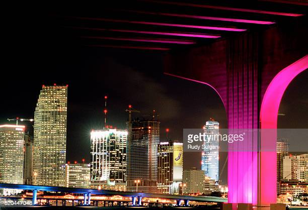 macarthur causeway bridge and skyline at night - magenta stock pictures, royalty-free photos & images