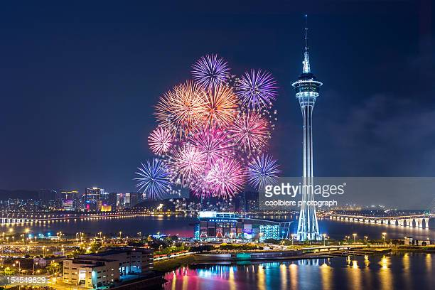 macau colourful fireworks over the bay - macao stock pictures, royalty-free photos & images