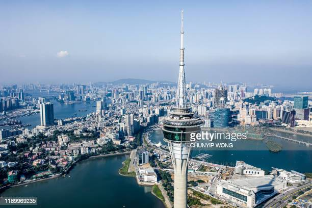 macau tower convention and city skyline - macao stock pictures, royalty-free photos & images