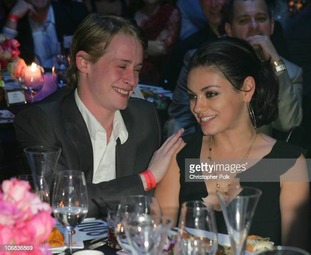 Macaulay Culkin and girlfriend Mila Kunis during Ubidcom Joins Forces with Hollywood Stars to Launch Celebrity Auction to Benefit Hurricane Victims...