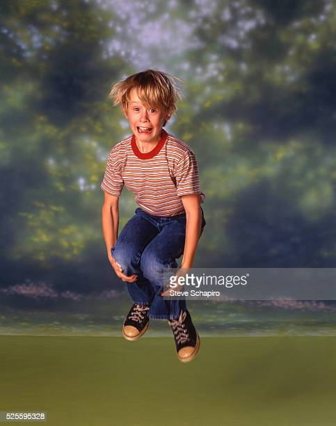 Macaulay Culkin jumping
