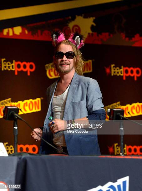 Macaulay Culkin speaks at the Robot Chicken Panel during New York Comic Con 2013 at the Javits Center on October 11 2013 in New York City...