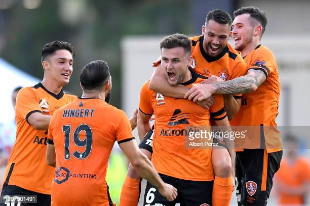 Macaulay Gillesphey of the Roar celebrates scoring a goal during the round 20 ALeague match between the Brisbane Roar and Perth Glory at Suncorp...