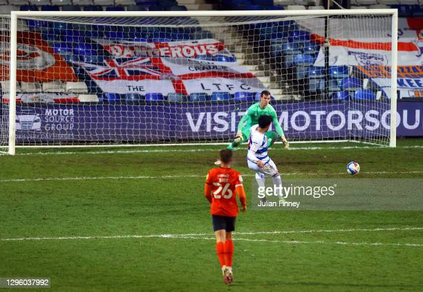 Macauley Bonne of Queens Park Rangers scores their team's first goal past Simon Sluga of Luton Town during the Sky Bet Championship match between...