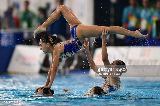 Macau's athletes compete in the women artistic swimming technical routine competition during the 2018 Asian Games in Jakarta on August 29 2018