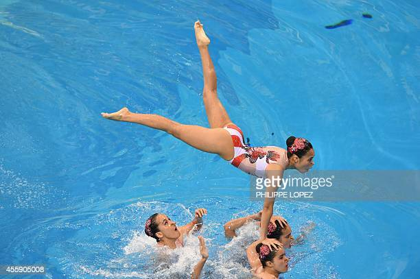 Macau's team compete in the team free routine final synchronised swimming event during the 2014 Asian Games at the Munhak Park Taehwan Aquatics...