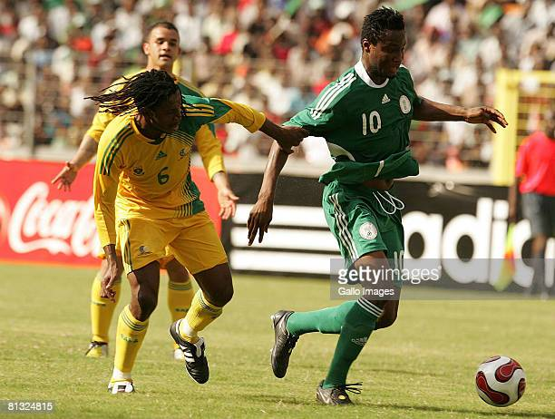 Macbeth Sibaya of South Africa and John Obi Mikel of Nigeria in action during the AFCON and 2010 World Cup Qualifier between Nigeria and South Africa...