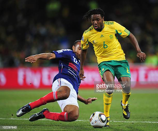 MacBeth Sibaya of South Africa is challenged by Thierry Henry of France during the 2010 FIFA World Cup South Africa Group A match between France and...