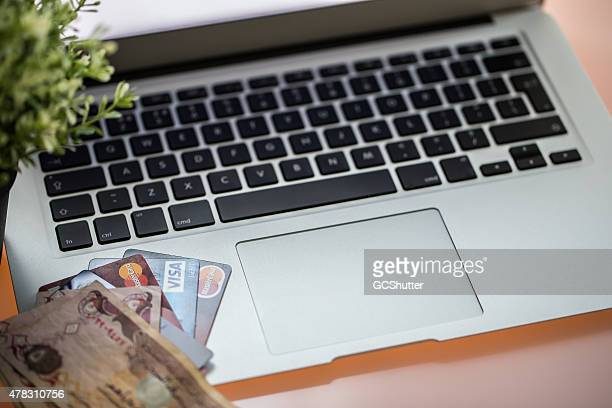 MacBook Air with Credit Cards and Currency Notes